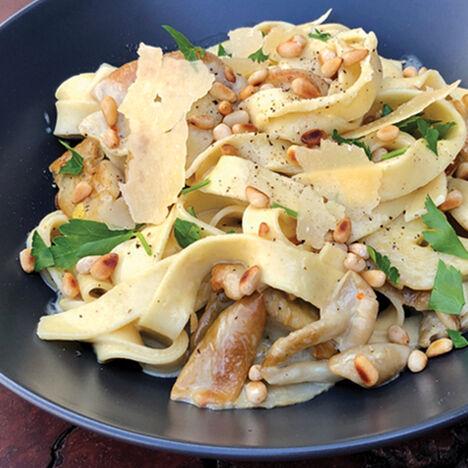 A bowl of creamy mushroom pasta