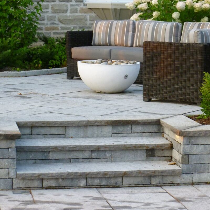 Backyard patio with custom built stone steps