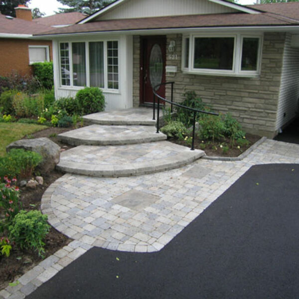 Home entrance way with custom steps built with unit pavers