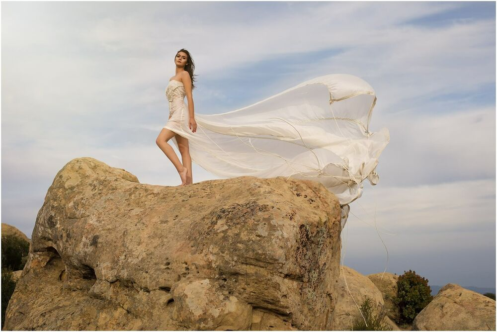 fashion portrait of a woman  in hand made parachute dress at Lizards Mouth in santa barbara standing on rock