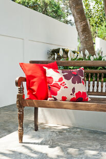 Bring soft furnishings outdoors to turn your garden into another room