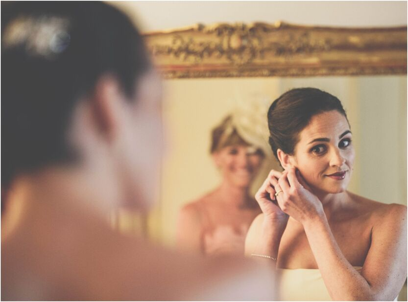 bride in mirror during the morning of the wedding in Verona Italy