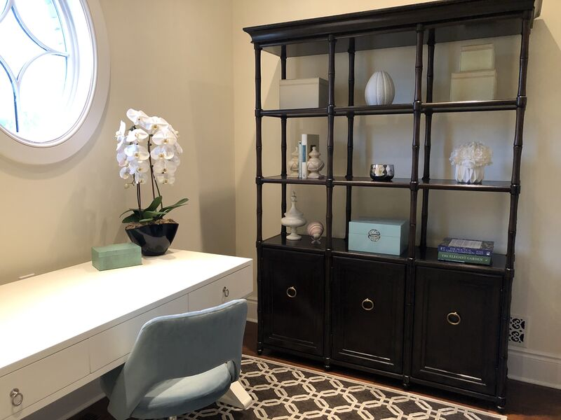 Bright hers home office with etagere bookcase, graphic area rug and simple stylish white desk