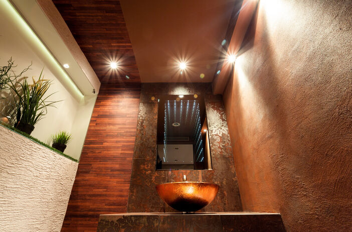 Luxury WC Bathroom with wood, copper and course plaster effects
