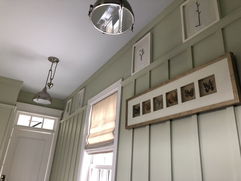 light sage board and batten mudroom with custom cabinetry and farmhouse industrial pendant lighting