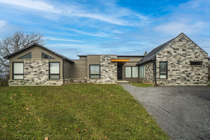 Modern New Construction Home with Stone Facade