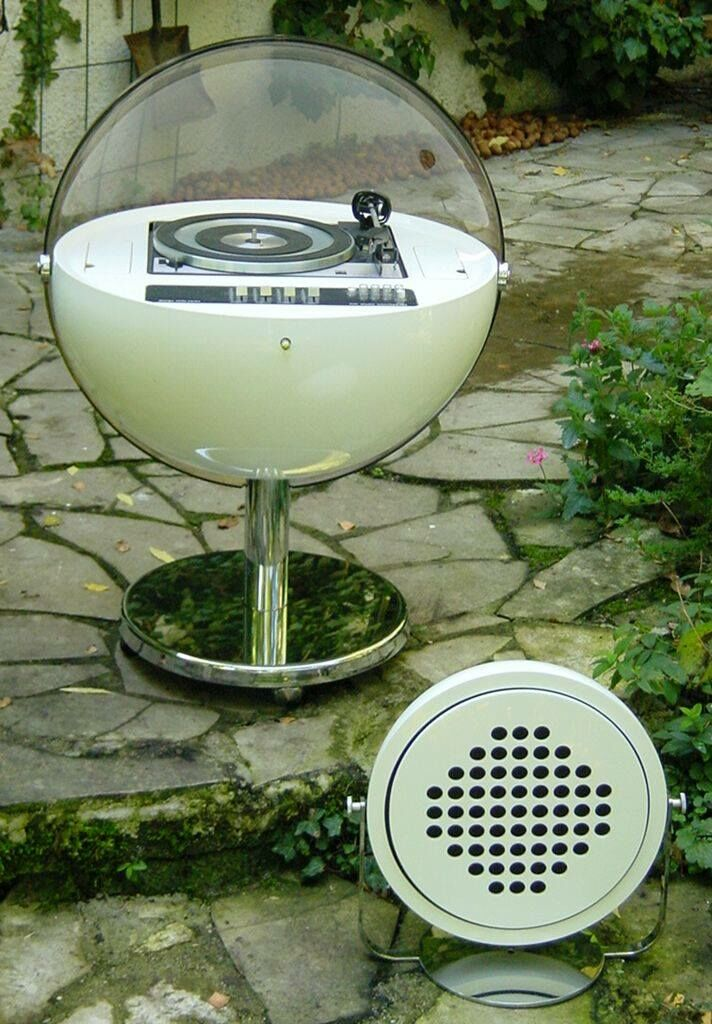 This is a mid sixties Space Age vinyl record player in the shape of a sphere lilke a planet