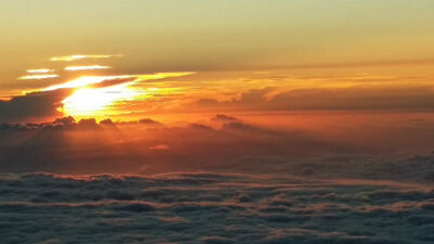Panoramic view of sunset over a sea of clouds