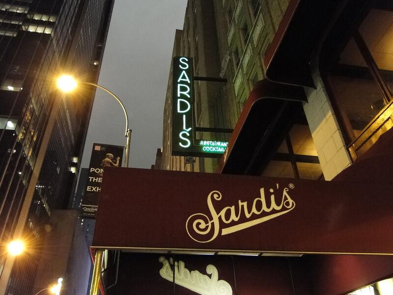 Exterior Sardi's awning looking up towards the sky at nighttime