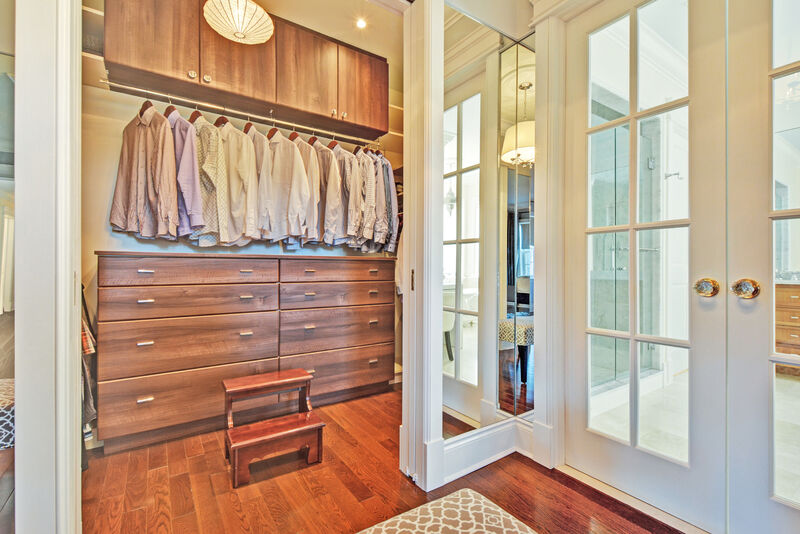 His master closet with custom cabinetry