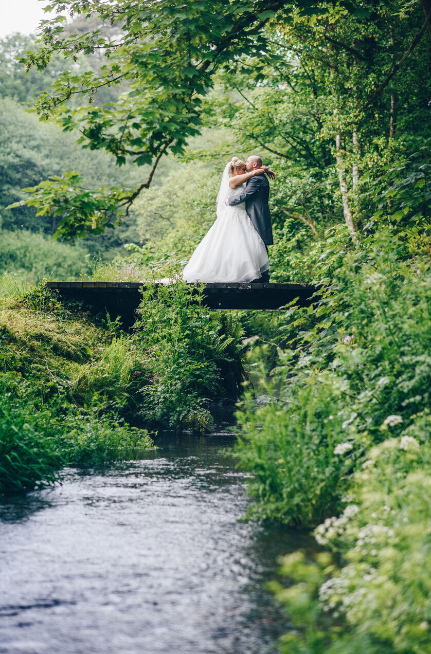 Wedding photography on the bridge at Fairyhill, Gower