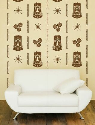 This is a fifties or midcentury sofa in front of tiki mask face wallpaper