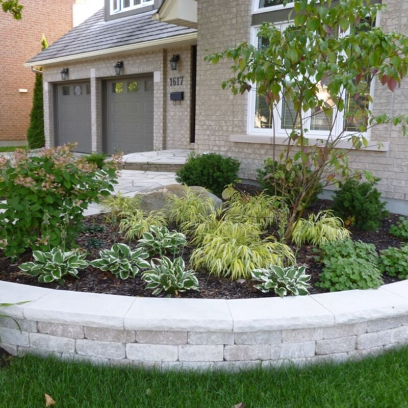 Front yard garden enclosed by a retaining wall