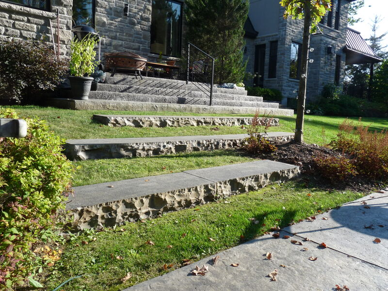 natural stone steps in lawn leading from pool patio to house