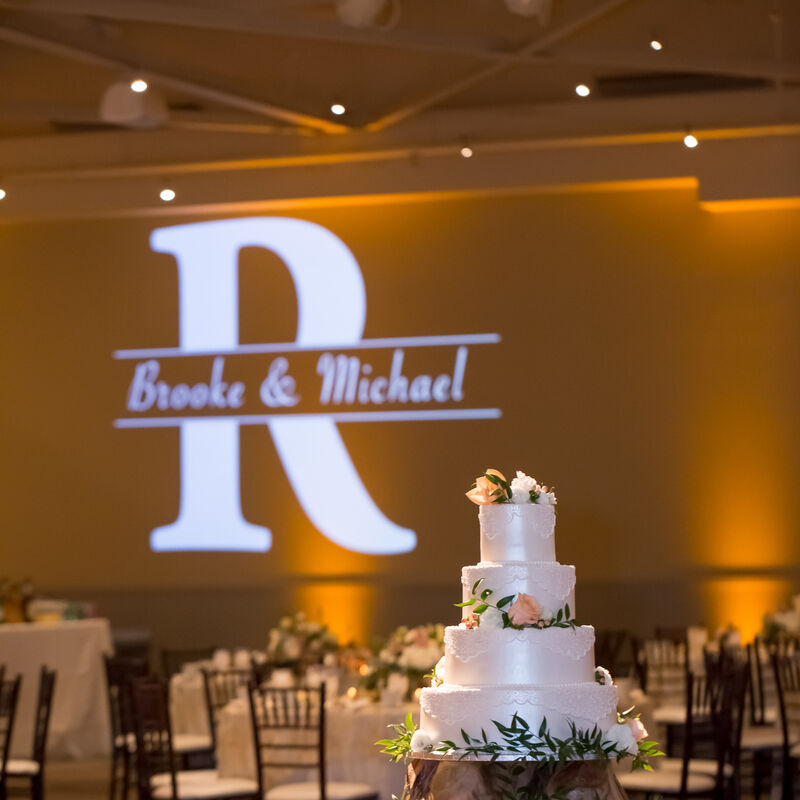 2nd II None monogram at a wedding reception with amber uplighting