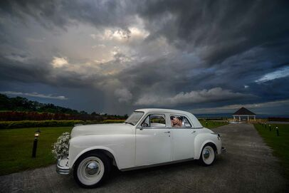 beautiful image of a wedding couple inside a car photographed by Benjamin Young III