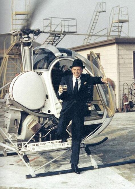 www.rockin-t-shirts.com.How cool can you be... Frank Sinatra stepping out of a helicopter in Las vegas with a glass of liquor in hand...