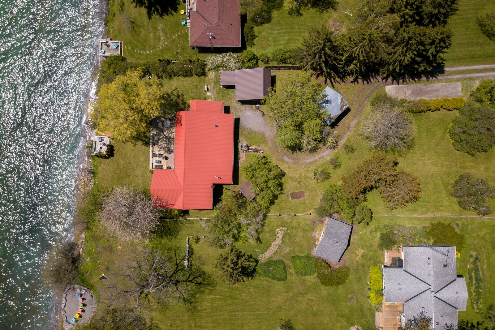 Bird's eye view of a waterfront cottage on Lake Ontario in Wellington ON