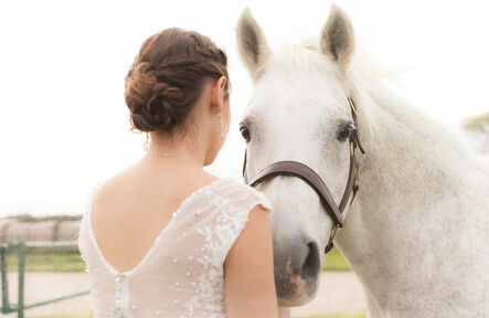 Texas Country Bride and Stallion at JM Prosperity Farm Rustic Barn Venue in Argyle Texas. Photo by Sergio Mendez at Blazin Events.