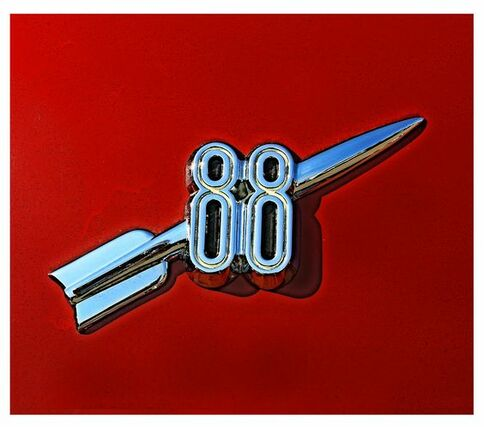 This is a chrome badge for the 50[s model Oldsmobile Rocket 88 car