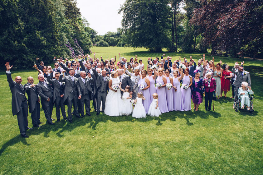 Large group photograph at Fairyhill wedding venue, Gower, Swansea