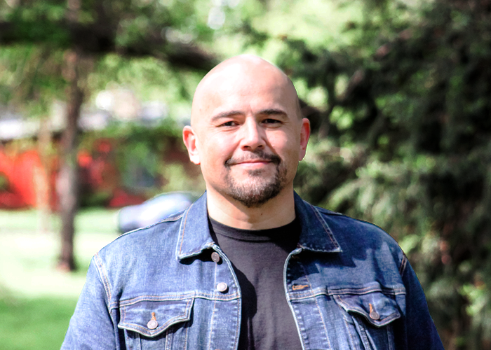 Link to bio for Angel Flores, Lead Pastor
