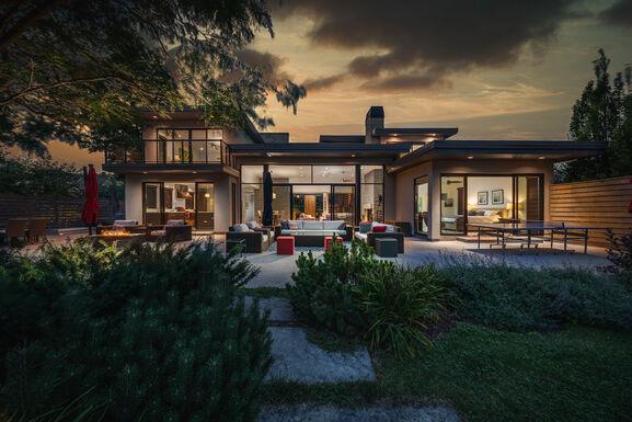 Twilight photo of large modern home