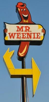 This is a midcentury vintage road sign in neon for Mr Weenie a fast food restaurant
