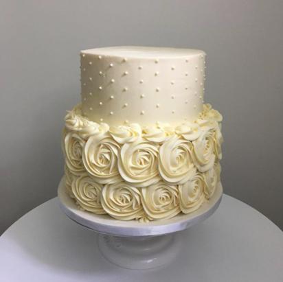 wedding cake designed with rose pattern