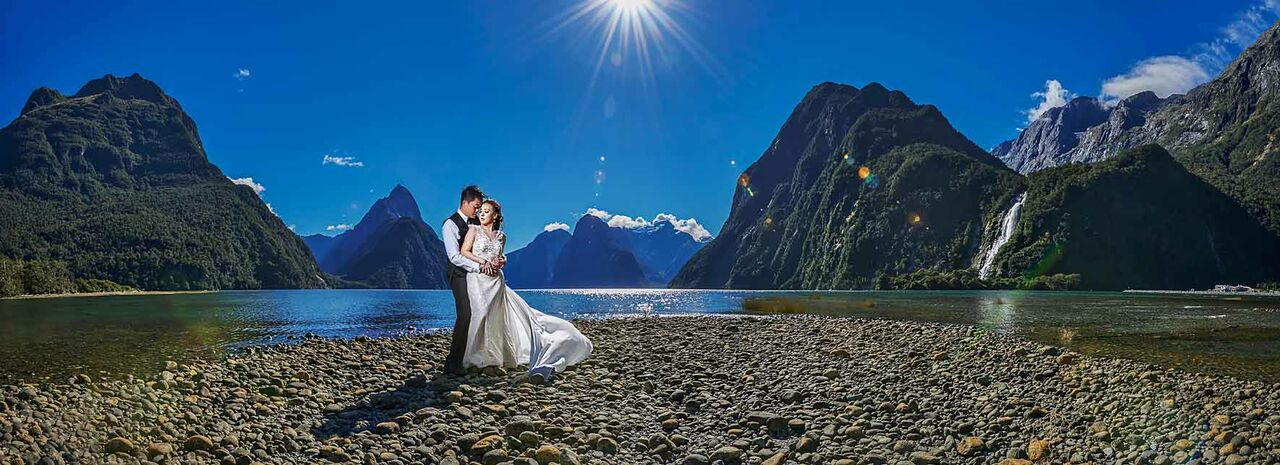 shot at the famous milford sound in new zealand wedding couple