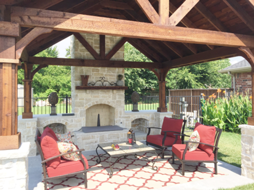 Custom designed outdoor living space with outdoor fireplace in Southlake, TX