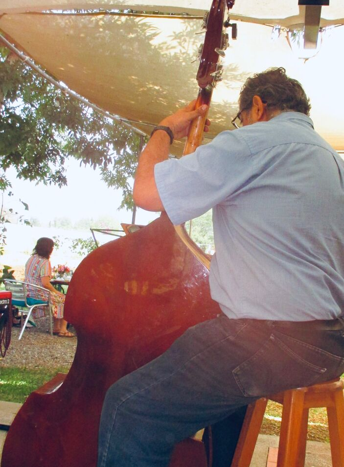 Playing his upright bass.