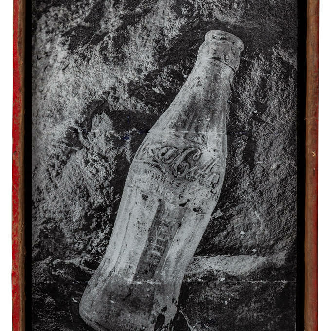 Photograph of a antique Coke bottle photographed in Mammoth Cave during a restoration project, printed hand transferred to a distressed aluminum plate, then float mounted with bolts in a coke crate. The crate can be hung on the wall or stand on a table.