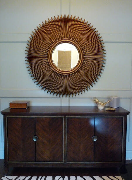 modern credenza in modern designed home office with large round mirror