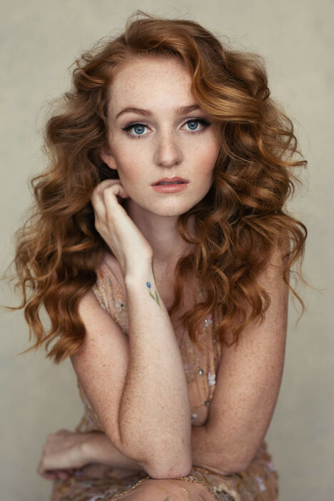 portrait of a beautiful red head in studio photography fashion