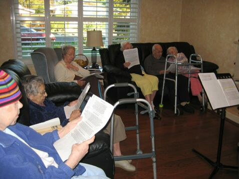 Group of seniors singing along to songs